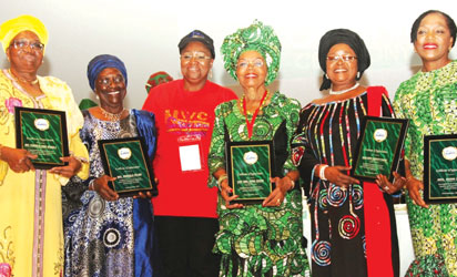 "First Lady of Lagos State and Chairman, Committee of Wives of Lagos State Officials (COWLSO), Dame Emmanuella Abimbola Fashola (3rd left) with the awardees: Iya Oge of Lagos, Chief Opral Benson (3rd right); Iyalode of Lagos, Hajia Bintu Tinubu (2nd right); Mrs. Wonu Folami (2nd left); Mrs. Feyintola Muri-Okunola (left) and former Special Adviser on Central Business District, Mrs. Derin Disu (right) during the opening ceremony of the 2014 National Women Conference with the theme, ""Embracing and Managing Change"", organised by the Committee of Wives of Lagos State Officials (COWLSO) in Lagos."