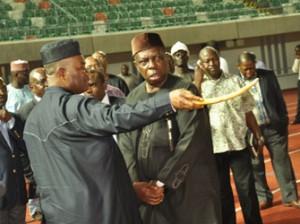•Governor Godswill Akpabio and Paul Bassey at the Uyo International Stadium.