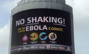 "A picture taken in Oshodi Heritage park in Lagos on October 20, 2014 shows an electronic information board on Ebola reading in pidgin English ""No Shaking ! We go Chase Ebola Comot"" which means ""No cause for worry, we will chase Ebola away"".  Africa's most populous nation Nigeria was on Monday declared officially Ebola free but warned that it remained vulnerable as long as the virus was raging elsewhere in west Africa. The country representative of the World Health Organization, Rui Gama Vaz, said 42 days -- or two incubation periods of 21 days -- had elapsed without any new confirmed cases of the deadly virus. AFP PHOTO"