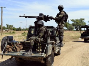 File: Cameroonian soldiers patrol on November 12, 2014 in Amchide, northern Cameroon, 1 km from Nigeria. The city was raided by Islamists from Nigeria's Boko Haram, killing eight cameroonian soldiers and leading the population to flee on October 15, 2014, before another six coordinated attacks that killed at least three civilians in the remote north of the country, on November 9, 2014. Boko Haram's five-year insurgency in neighboring Nigeria has left thousands dead, and the Islamists have occasionally carried out attacks over the border. Cameroon has deployed more than 1,000 soldiers in the extreme northeast of the country to counter the Islamist threat. AFP PHOTO