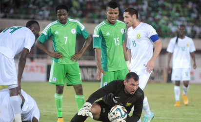 South African goalkeeper Darren Keet reacts after he was injured during the 2015 Africa Cup of Nations qualifying football match between Nigeria and South Africa at Akwa Ibom stadium in Uyo, Nigeria, on November 19, 2014. AFP PHOTO