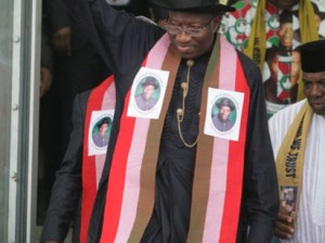 PRESIDENT GOODLUCK AKNOLEDGING CHEERS FROM HIS SUPPORTES