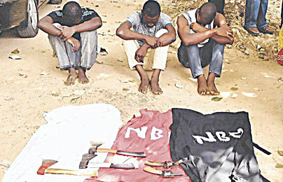 *The suspects with arms allegedly recovered from them
