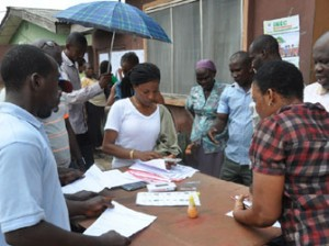 Residents of Sebiotimo street, Agege, checking for their Permanent Voters Cards at  ward 5, Agage Local Government in, Lagos state,  yesterday [08-11-14]. Photo: Bunmi Azeez