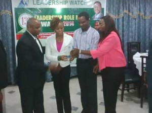 Mr. Simon Tachie, Director, Hospital Administration, First Consultant Medical Centre, and other staff of the hospital receiving the Leadership Watch, 13th Annual Leadership Role Model Awards 2014, on behalf of Dr. Ameyo Stella Adadevoh