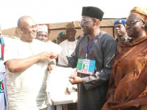 Governor Abdulfatah Ahmed of Kwara State (2nd right) receiving his certificate of return.
