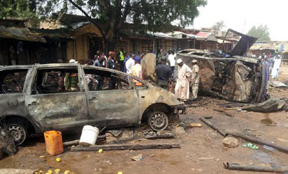 BOMBING—Scene of the bomb blast at Dukku Motor Park in Gombe where 20 people died and 25 sustained various degrees of injuries, yesterday. Photo: NAN.