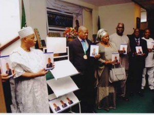 •The author Chief Poly Emenike(2nd left) with other dignitaries during the presentation