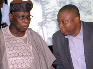 Author/Former President Olusegun Obasanjo, (left) with the Publisher of the Book ,Dr Eghosa Imasuen, at the presentation of a Book Tittle: ''My Watch'', By Olusegun Obasanjo in Lagos... yersterday 09/12/2014