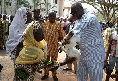 Ekiti State Governor, Mr Peter Ayodele Fayose distributing chicken, rice and money to the widow and aged in Ado Ekiti yesterday for the Christmas under the stomach infrastructure programme of his administration