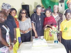 •National Executives of Association of Nigerian Authors and representative of the president,Molara Wood cutting the 33rd anniversary cake in Ibadan recently