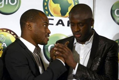 CONGRATULATION: Enyeama (l) congratulates Yaya Toure at the Glo-CAF Award ceremony