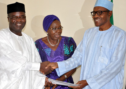 PDM adopt Buhari: National Chairman of Peoples Democratic Movement (PDM), Bashir Yusuf Ibrahim (left) presenting resolution of the National Executive Committee of the party  to adopt Gen. Muhammadu Buhari of APC as their Presidential Candidate to Buhari, while Deputy National Chairman South West, Mrs Titilayo Ajanaku looks on in Abuja. Photo: Gbemiga Olamikan.