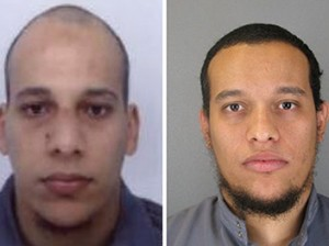 """This combo shows handout photos released by French Police in Paris early on January 8, 2015 of suspects Cherif Kouachi (L), aged 32, and his brother Said Kouachi (R), aged 34, wanted in connection with an attack at the satirical weekly Charlie Hebdo in the French capital that killed at least 12 people. French police on January 8 published photos of the two brothers wanted as suspects over the bloody massacre at the magazine in Paris as they launched an appeal to the public for information.   AFP PHOTO / FRENCH POLICE -- EDITORS NOTE --- RESTRICTED TO EDITORIAL USE -- MANDATORY CREDIT """"AFP PHOTO / FRENCH POLICE"""" NO MARKETING - NO ADVERTISING CAMPAIGNS -- DISTRIBUTED AS A SERVICE TO CLIENTS"""