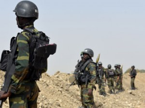A picture taken on February 17, 2015 shows Cameroonian soldiers patrolling in the Cameroonian town of Fotokol, on the border with Nigeria, after clashes occurred on February 4 between Cameroonian troops and Nigeria-based Boko Haram insurgents. Nigerian Boko Haram fighters went on the rampage in the Cameroonian border town of Fotokol on February 4, massacring dozens of civilians and torching a mosque before being repelled by regional forces   AFP PHOTO