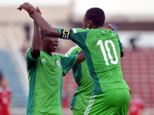 CHEERS! . . . Golden Eaglets captain Kelechi Nwakali celebrates with a teammate after beating Niger Republic 2-0 at CAF U-17