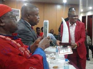 •Festus receiving tusks and certificate at the ceremony