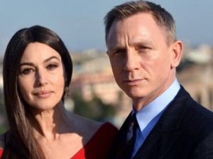 Italian actress Monica Bellucci and British actor Daniel Craig pose during a photocall to promote the 24th James Bond film 'Spectre' on February 18, 2015 at Rome's city hall.   AFP PHOTO