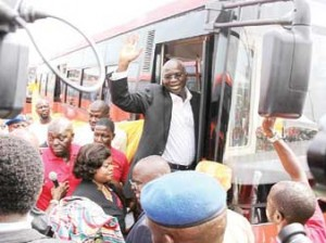 Governor Fashola aboard one of the 100 air-conditioned Wifi buses