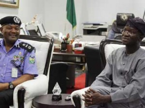 Lagos State Governor, Mr. Babatunde Fashola, SAN (right) discussing with the Assistant Inspector- General of Police, Zone II, Mr. Joseph Mbu (left) during his courtesy visit to the Governor at the Lagos House, Ikeja, on Tuesday, February 03, 2015.