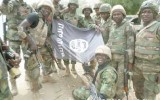 •Troops with a dismantled Boko Haram flag