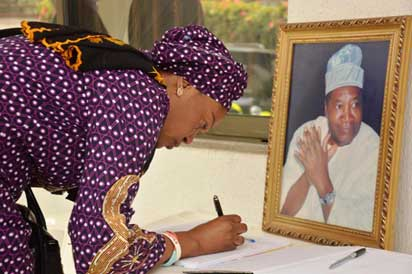 CONDOLENCE: Senator Oluremi Tinubu signing the condolence register at the home of the deceased yesterday.