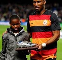Drogba (r) and Son, Isaac