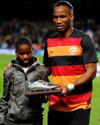 Drogba (r) and Son, Isaac
