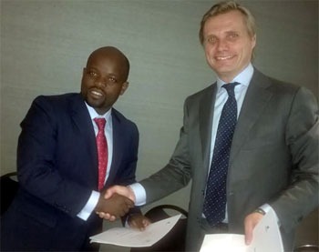From left:Jean Philbert Nsengimana, Minister, Youth and ICT, Rwanda and Fredrik Ledling, President, Ericsson, Sub-Sharan Africa yesterday at the signing in of Memoranda of Understanding between Ericsson and Government of Republic of  Rwanda on smart city initiative at the ongoing Mobile World Congress holding in Barcelona, Spain. Photo by Emeka Aginam