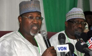 Presidential Election : From left, INEC Commissioner, Engr. Dr Nuru Yakubu, INEC Chairman Prof. Attahiru Jega and INEC National Commissioner Col. Mohammed Hammanga  (rtd) addressing Pressmen on Presidential Election in Abuja. Photo by Gbemiga Olamikan.