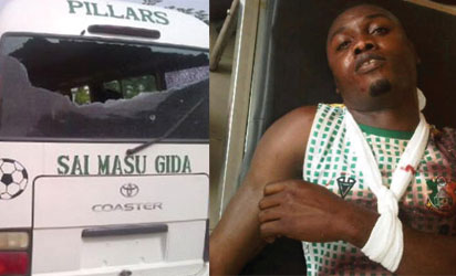 The Kano Pillars bus after the attack avd Gambo Muhammed in pain