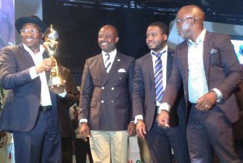 President Jonathan (l) with the FIFA trophy.