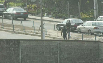 File: Armed robbers in military fatigue during Lekki Robbery.