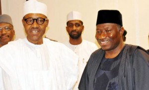 PRESIDENT-ELECT RETIRED MAJ.-GEN. MUHAMMADU BUHARI (L) IN A HANDSHAKE WITH PRESIDENT GOODLUCK JONATHAN  DURING HIS OFFICIAL VISIT TO THE PRESIDENTIAL VILLA IN ABUJA ON FRIDAY (24/4/15).WITH THEM IS THE FORMER CHIEF OF ARMY STAFF,RETIRED LT.-GEN. ABDUHRAMAN DAMBAZAU.