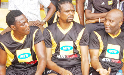 From left, Sound Sultan, Nwankwo Kanu and Waidi Akanni try to catch their breath during the half-time