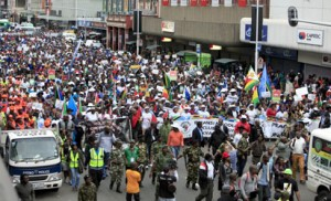 "Thousands of people take part in the ""peace march"" against xenophobia in Durban, South Africa, on April 16, 2015. South African President Jacob Zuma on April 16 appealed for the end of attacks on immigrants as a wave of violence that has left at least six people dead threatened to spread across the country. In the past two weeks, shops and homes owned by Somalis, Ethiopians, Malawians and other immigrants in Durban and surrounding townships have been targeted, forcing families to flee to camps protected by armed guards.   AFP PHOTO"
