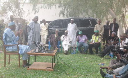 Buhari meeeting speaking  Journalists  at his Dura home