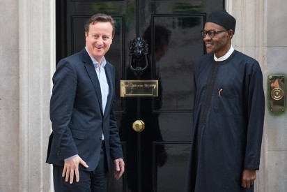 Britain's Prime Minister David Cameron (L) stands with Nigeria's President-elect Muhammadu Buhari following a meeting in Downing Street, central London on May 23, 2015. AFP PHOTO / LEON NEAL