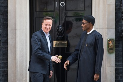 Britain's Prime Minister David Cameron (L) speaks with Nigeria's President-elect Muhammadu Buhari following a meeting in Downing Street, central London on May 23, 2015. AFP PHOTO / LEON NEAL