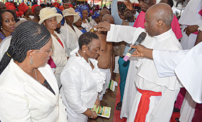Apostle Pat Alile being anointed by Spiritual Leader, Apostle Hayford ALILE.
