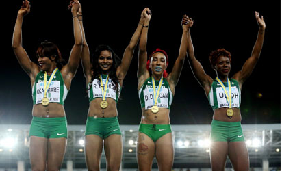 NASSAU, BAHAMAS - MAY 02: Blessing Okagbare, Regina George, Dominiue Duncan, and Christy Udoh of Nigeria celebrat on the podium after winning the final of the women?s of the 4 x 200 metres on day one of the IAAF World Relays at Thomas Robinson Stadium on May 2, 2015 in Nassau, Bahamas.   Streeter Lecka/Getty Images for IAAF/AFP
