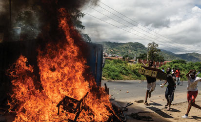 "People burn mattresses looted from the local police post on 13 May, 2015 in Musaga neighborhood in Bujumbura, during a protest against incumbent president Pierre Nkurunziza's bid for a 3rd term. Protestors looted the local police post in Musaga, burning furniture, mattresses and clothing in a barricade fire, an AFP photographer said. Burundi's presidency said an attempted coup by a top general had ""failed"" on May 13, 2015 and pro-president Burundi troops at state broadcaster fire warning shots over the heads of hundreds of protesters. Nkurunziza, who was attending a regional crisis meeting in neighbouring Tanzania, flies home to Burundi on May 13 hours after Burundian general Godefroid Niyombare announced a coup. AFP PHOTO"