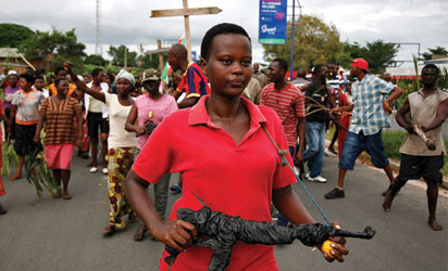 Demonstrators take part in a protest in Bujumbura on May 13, 2015. A top Burundian general announced today the overthrow of President Pierre Nkurunziza, following weeks of violent protests against the president's bid to stand for a third term.  AFP PHOTO