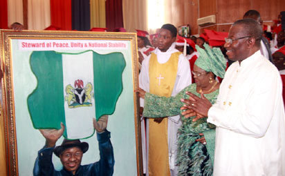 President Goodluck Jonathan and the First Lady, Dame Patience Jonathan appreciating a gift presented by the Church of Nigeria, Anglican Communion during the Special Church Service to mark the Thanksgiving and Farewell Service in honour of the First Family at the Cathedral Church of The Advent, Life Camp, Abuja. Photo by Abayomi Adeshida 10/05/2015