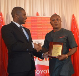 From left: Mr Ade-ojo, Managing Director Toyota Nigeria Limited, presents  the Motoring Journalists Award  to Mr Theodore Opara of Vanguard Motoring Editor, during the 2014 Toyota Customer Award Nite, held at Civic Centre, Victoria Island Lagos.