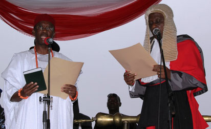 INAUGURATION: Senator Ifeanyi Okowa (left) subscribing to the relevant Oaths as Governor of Delta State presided over by the Chief Judge of Delta State, Hon. Justice Marshal Umukoro (right) during the inauguration ceremony in Asaba yesterday.