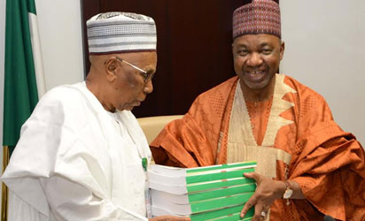 VICE  PRESIDENT  NAMADI SAMBO (R), PRESENTING  THE  PRESIDENTIAL HANDING OVER DOCUMENTS  TO THE  CHAIRMAN OF THE TRANSITION COMMITTEE, ALHAJI AHMAD  JODA  DURING THE JOINT MEETING OF THE TRANSITION COMMITTEE AT THE PRESIDENTIAL VILLA IN ABUJA ON MONDAY