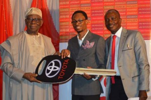 From left: Chief Micheal Ade-ojo, Chairman TNL, presents star prize of Toyota Avenza key to Mr Olanipekun Smith of FirstBank Plc, while Mr. Henry Ade Ojuoko, Head Dealer Development and Special Projects, TNL, watched during the 2015 Toyota Customer Award Nite, in Lagos.