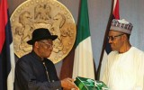 Handover : Jonathan presenting handing over notes to Buhari.