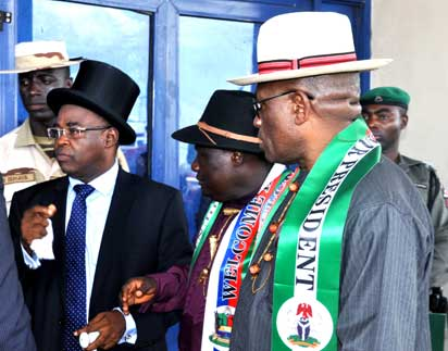 (Photo left)-Acting party Chairman, Barrister Serena Dokubo (left in top hat) accompanied by party leaders including Deputy Governor of Bayelsa State, Retired Rear-Admiral John Gboribiogha Jonah, (right) gather to welcome former President Jonathan in Yenagoa. Picture by Lindsay Barrett.
